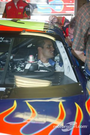 A rare sight: Juan Pablo Montoya in a race car with a roof