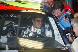 Juan Pablo Montoya listens to advice from Hendrick crew