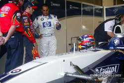 Jeff Gordon, left, listens to advice from Juan Pablo Montoya about the FW24