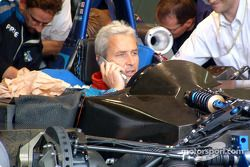 Phillippe Alliot takes a call