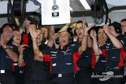 Minardi team members celebrate two fastest times