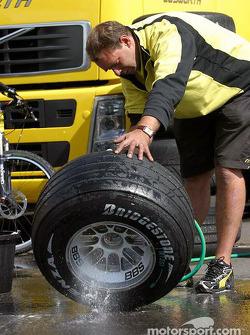 Jordan team member cleans up the wheels