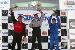 Podium: race winner Scott Pruett with Paul Gentilozzi and Jorge Diaz Jr.