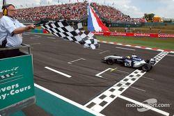 Ralf Schumacher takes the checkered flag