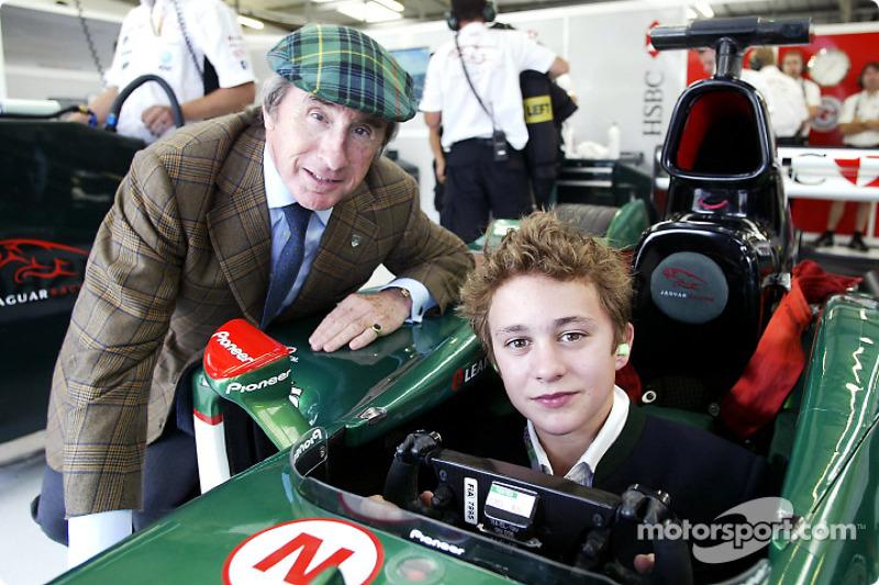 Jackie Stewart of Jaguar poses with The Duke of Kent's grandson, Edward Lord Downpatrick