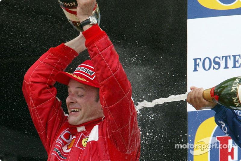 Podio: ganador de la carrera Rubens Barrichello, segundo lugar Juan Pablo Montoya y el tercer lugar Kimi Raikkonen
