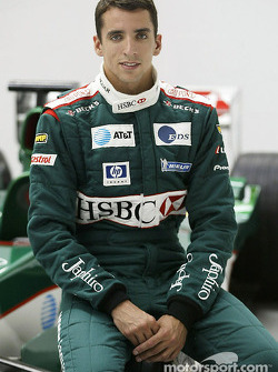 Justin Wilson poses with the Jaguar F1 car after his transfer to Jaguar Racing from Minardi at the J