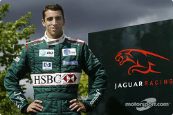 Justin Wilson poses after his transfer to Jaguar Racing from Minardi at the Jaguar Racing factory in
