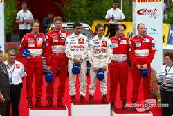 The podium: winner Sébastien Loeb and Daniel Elena, with Marcus Gronholm and Timo Rautiainen, and Ri