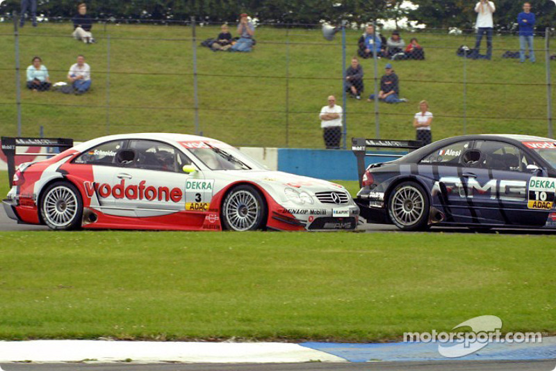 Bernd Schneider tries to pass Jean Alesi on lap one