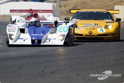 #20 Dyson Racing Team Lola EX257/AER: Christopher Dyson, Andy Wallace moving by #4 Corvette Racing C