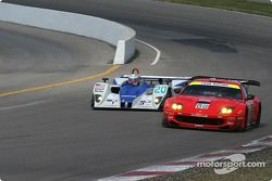 #20 Dyson Racing Team Lola EX257/AER MG: Chris Dyson, Andy Wallace, and #38 Champion Racing Audi R8: J.J. Lehto, Johnny Herbert