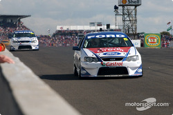 Team mates Glenn Seton and David Besnard down pit straight