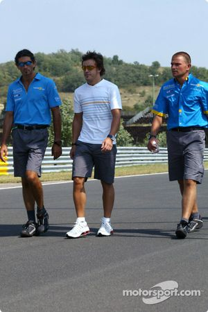 Fernando Alonso walks around track