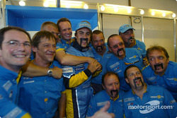 Fernando Alonso celebrates win with Renault F1 team members