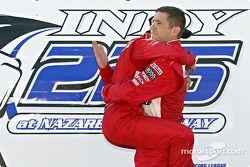 Race winner Helio Castroneves celebrates with Gil de Ferran