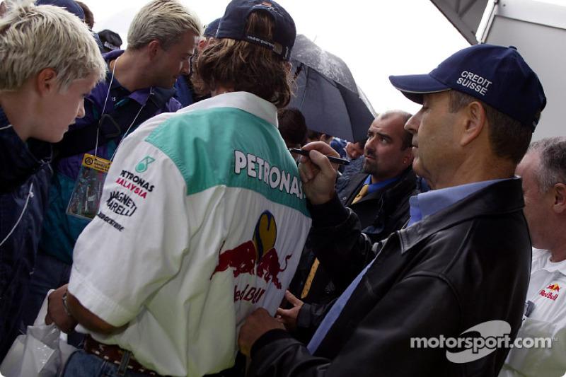 Peter Sauber signs autographs