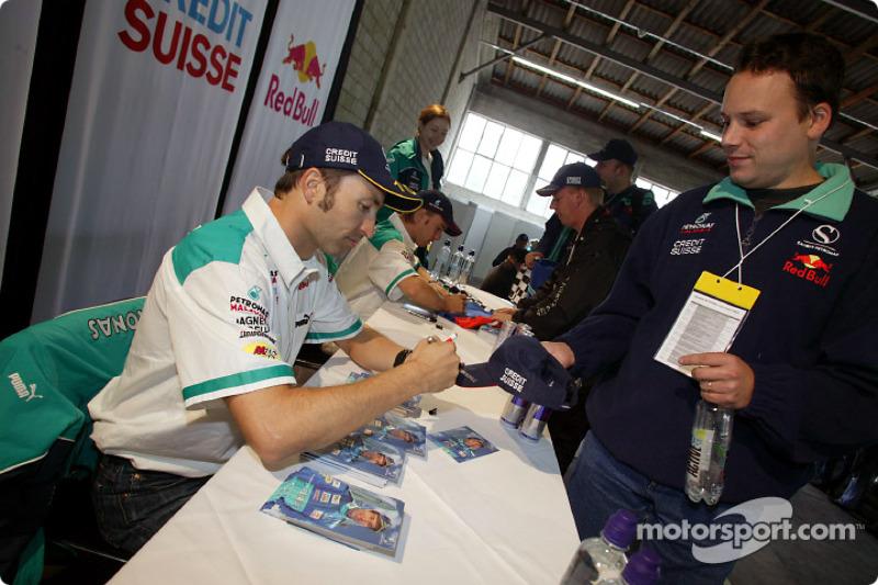 Heinz-Harald Frentzen and Nick Heidfeld sign autographs