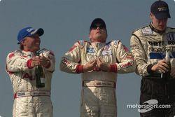Podium: champagne for J.J. Lehto, Johnny Herbert and Chris Dyson