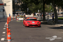 Market Street in Downtown San Jose became a temporary racing circuit Wednesday as cars from the ALMS took some demonstration laps around Cesar Chavez Park: the #80 Ferrari, driven by Jan Magnussen, leads the #31 Porsche driven by Johnny Mowlem