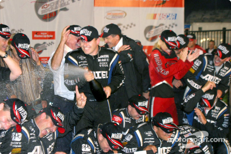 Ryan Newman celebrates with champagne