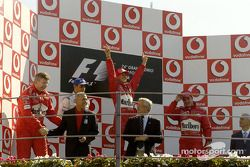 Podium: race winner Michael Schumacher with Juan Pablo Montoya and Rubens Barrichello