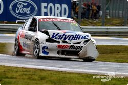 Jamie Whincup takes a shortcut after running wide
