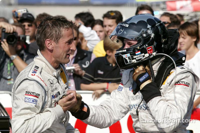 Race winner Christijan Albers congratulated by Bernd Schneider