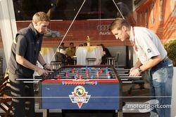 Peter Dumbreck and Bernd Schneider play table football