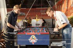 Peter Dumbreck and Bernd Schneider play table football