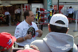 Toyota team member explains F1 steering wheel to fans