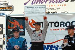 Podium: race winner Scott Pruett with Johnny Miller and Bobby Sak