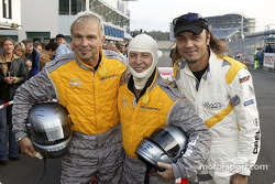 Rudolf Schenker, Klaus Meine and Matthias Jabs from the Scorpions prior to a ride in the racing taxi