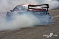 Timo Scheider and Mattias Ekström smoke the tires