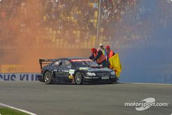 Race winner Jean Alesi celebrates