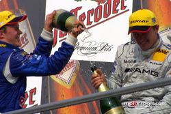 Podium: champagne for Mattias Ekström and Marcel Fassler