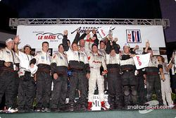 Race winners J.J. Lehto and Johnny Herbert celebrate with ADT Champion Racing team members