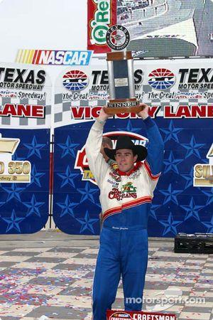 Victory lane: race winner Brendan Gaughan celebrates