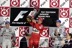Podium: Sieger Rubens Barrichello, 2 Kimi Räikkönen, 3. David Coulthard