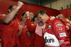 Michael Schumacher celebrates sixth world championship with Ferrari team members