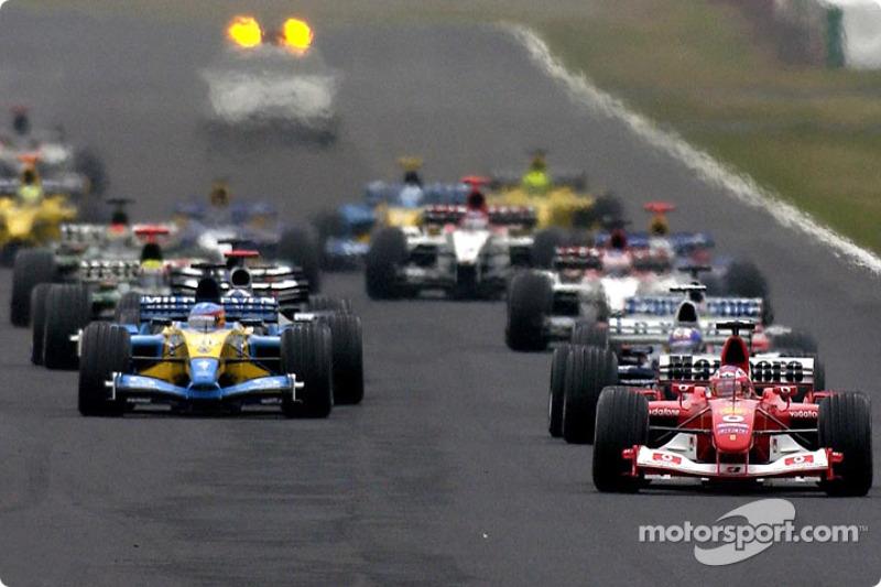 Rubens Barrichello takes the lead at the start