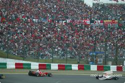 Takuma Sato y Michael Schumacher