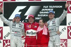 Podium: race winner Rubens Barrichello with Kimi Raikkonen, David Coulthard and Jean Todt
