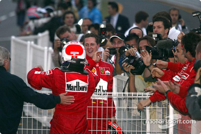 Michael Schumacher and Rubens Barrichello congratulate each other