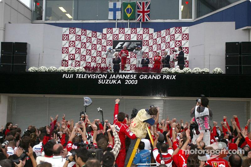 Podium with winner Rubens Barrichello, Kimi Raikkonen second and David Coulthard third