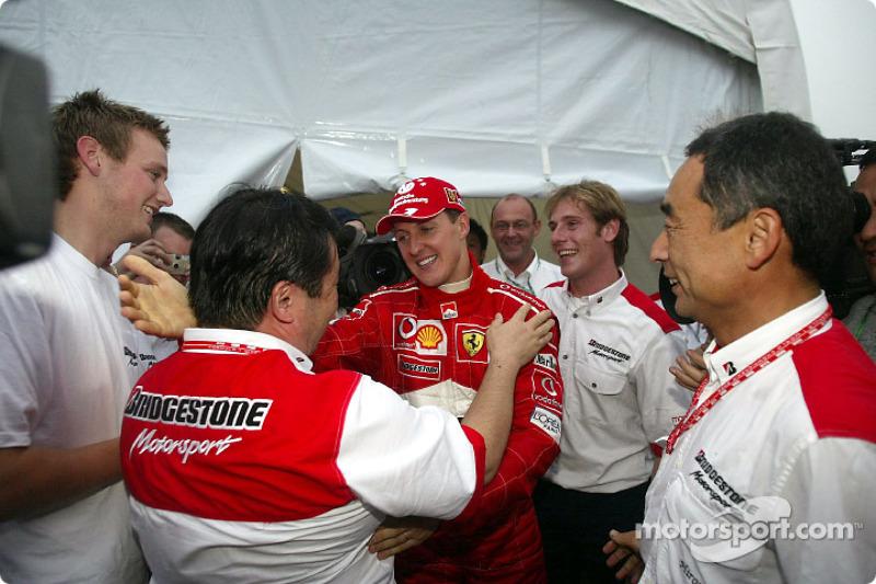 Bridgestone staff congratulate Michael Schumacher