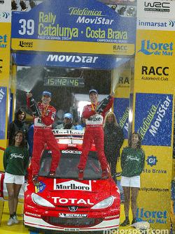 Podium: winners Gilles and Hervé Panizzi celebrate