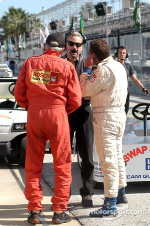 Kevin Jeannette talks with his drivers Milt Minter and Chad McQueen