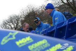 Petter Solberg and team discus tactics