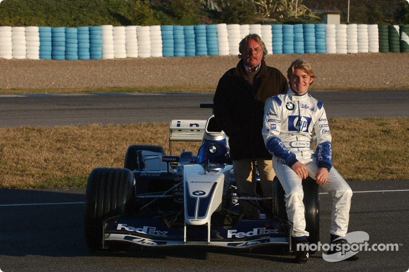 Nico Rosberg and father Keke pose with the WilliamsF1 BMW FW25